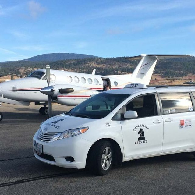 Taxi Van in front of private plane